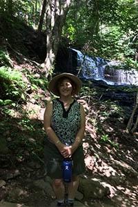 woman hiking Rickett's Glen State Park Falls Trail