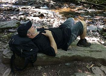 man napping on rocks