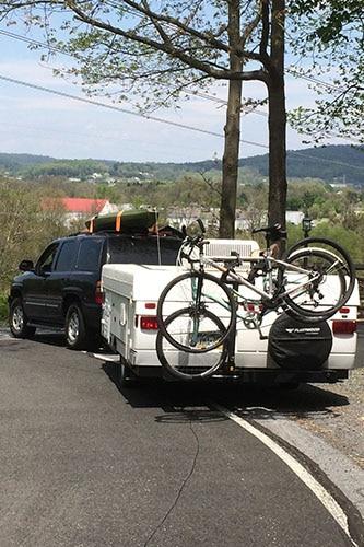 bikes on rack on back of pop up camper